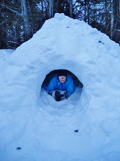 In a quinzhee (traditional Native American snow shelter) in the North Woods of New Hampshire, near the borders of Maine and Quebec, February 2015. Photo by Chelsea Scudder.]